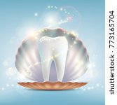 human tooth in a seashell.... | Shutterstock .eps vector #773165704