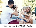 young happy family is enjoying...   Shutterstock . vector #773210404