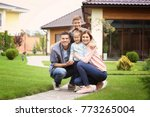 happy family in courtyard near... | Shutterstock . vector #773265004