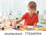 talented boy painting at table... | Shutterstock . vector #773269354