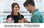 caucasian couple exchange gift... | Shutterstock . vector #773324824