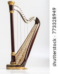 Small photo of Celtic irish harp, classical and traditional string music instrument, isolated white background