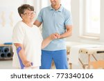 smiling physiotherapist... | Shutterstock . vector #773340106