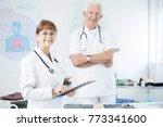 smiling elderly doctors in... | Shutterstock . vector #773341600
