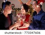 cheeful coworker drinking... | Shutterstock . vector #773347606