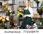 attractive woman florist in... | Shutterstock . vector #773358979