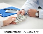 woman giving money to doctor in ... | Shutterstock . vector #773359579