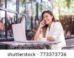 beautiful girl is talking on...   Shutterstock . vector #773373736