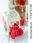 red flower bouquet with lantern | Shutterstock . vector #773375758
