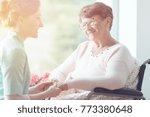 young volunteer holding hands... | Shutterstock . vector #773380648
