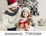 surprise  chritsmas prsent for... | Shutterstock . vector #773419684