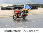 motorcyclist with flags. st.... | Shutterstock . vector #773421574