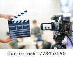 man hands holding movie clapper.... | Shutterstock . vector #773453590