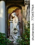 """Small photo of Antique style woman statue at the """"Alter Zwoelf-Apostel-Kirchhof"""" (""""Old Twelve Apostles Cemetery"""") in Berlin-Schoeneberg, one of the most important historical graveyards in Berlin"""