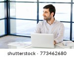 handsome businessman working at ... | Shutterstock . vector #773462680