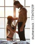 sexy woman kneeling before man. ... | Shutterstock . vector #773470159