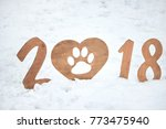 wooden sign 2018 in the snow... | Shutterstock . vector #773475940