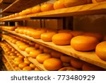Rows Of Cheese Pieces On Woode...