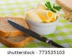 butter curls and bread | Shutterstock . vector #773535103