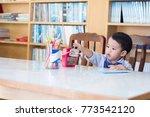 the adorable little asian boy... | Shutterstock . vector #773542120