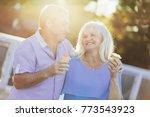 older couple eating ice cream... | Shutterstock . vector #773543923