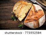 rustic loaf of homemade bread...   Shutterstock . vector #773552584