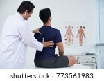 doctor checking spine of a... | Shutterstock . vector #773561983