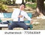 asian businessman sitting in a...   Shutterstock . vector #773563069