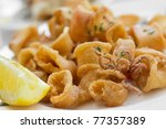 Italian fried calamari rings - stock photo