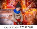 cute child boy is sitting near... | Shutterstock . vector #773592484