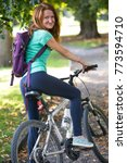girl on a bicycle in the park   | Shutterstock . vector #773594710