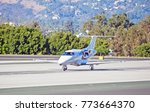 Small photo of SANTA MONICA/CALIFORNIA - OCT. 22, 2017: Embraer Phenom 100 accelerating as it departs Santa Monica Airport. Santa Monica, California USA