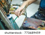 artist paints picture by oil... | Shutterstock . vector #773689459