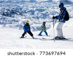 father and two boys  skiing on... | Shutterstock . vector #773697694