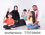 arab family sitting at home... | Shutterstock . vector #773718604