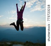 woman jumps on a top of...   Shutterstock . vector #773723218