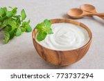 yogurt in wooden bowl   Shutterstock . vector #773737294
