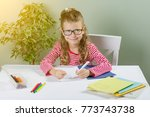 a junior schoolgirl with... | Shutterstock . vector #773743738