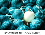 one white ball in a pile of... | Shutterstock . vector #773746894