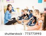 beautiful preschool teacher and ... | Shutterstock . vector #773773993