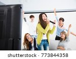 young woman holding microphone...   Shutterstock . vector #773844358