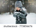 Cute Little Boy Blowing Snow...