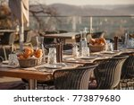served table at summer terrace... | Shutterstock . vector #773879680