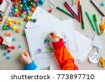a boy draws a christmas tree.... | Shutterstock . vector #773897710