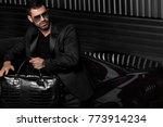 handsome brutal man in the car | Shutterstock . vector #773914234