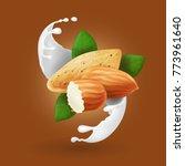 milk splash with almond nut.... | Shutterstock .eps vector #773961640