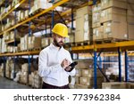 warehouse worker or supervisor... | Shutterstock . vector #773962384