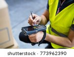 male warehouse worker with... | Shutterstock . vector #773962390