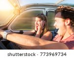 couple in a car at sunset  with ... | Shutterstock . vector #773969734