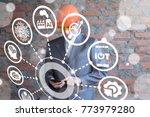businessman in safety helmet... | Shutterstock . vector #773979280